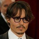 Johny Depp wears Horn rimmed